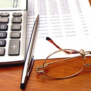 Charleston Accounting Services - Calculator, Pen, and Glasses